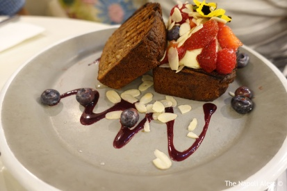 Banana bread sandwich, mascarpone, fresh berries, flaked almonds, honey