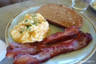 Scrambled eggs with dry cured bacon